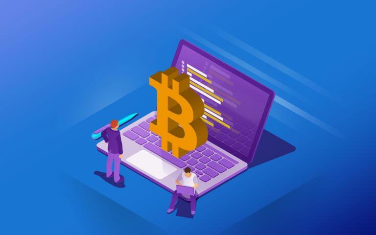 Bitcoin auf Laptop, mit Menschen drumherum